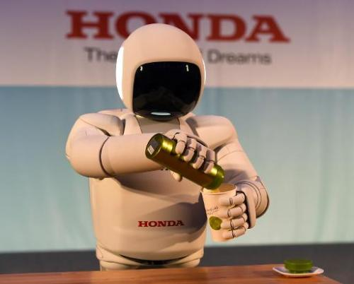 Honda North America makes their North American debut of their new Asimo Robot as it demonstrates its ability to pour a liquid at