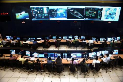 Indian scientists and engineers of Indian Space Research Organization (ISRO) monitor the Mars Orbiter Mission (MOM) at the track