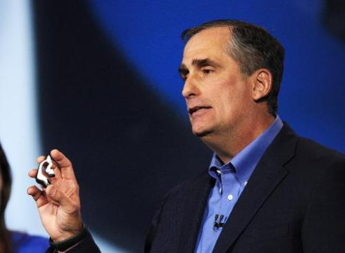 Intel Corp. CEO Brian Krzanich displays the Intel smart headset and earbud designs, providing full stereo audio, heart rate moni