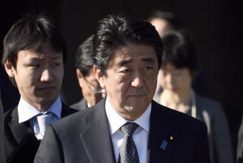Japanese Prime Minister Shinzo Abe leaves is welcomed at the Invalides in Paris on May 5, 2014