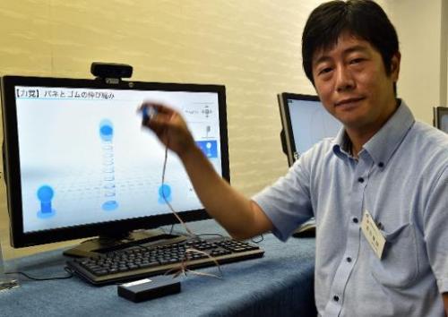 "Japan's high-tech venture Miraisens CEO Natsuo Koda demonstrates ""3D-Haptics Technology"" at a press preview in Tsukuba"