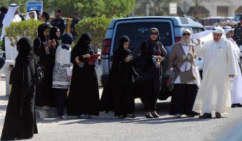 Kuwaiti activists gather outside the courthouse in Kuwait City on November 3, 2011 where two fellow leading youth activists were