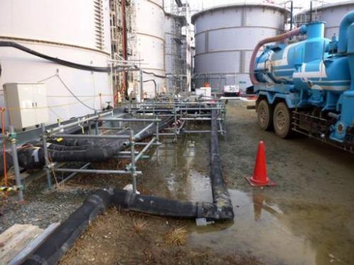 Leaked contaminated water is shown around a tank at TEPCO's Fukushima Dai-ichi nuclear power plant at Okuma in Fukushima prefect