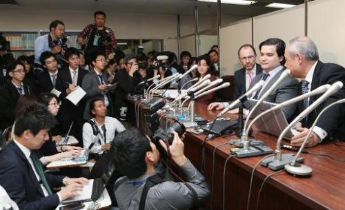 Mark Karpeles (2nd R), president of MtGox Bitcoin exchange, speaks during a press conference in Tokyo on February 28, 2014