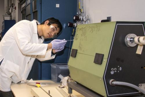 Material scientist exploring ways to improve efficiency of solar cells