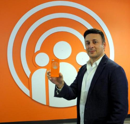 Michael Chasen, founder and chief executive of SocialRadar, poses in his offce in Washington, DC, on January 24, 2014