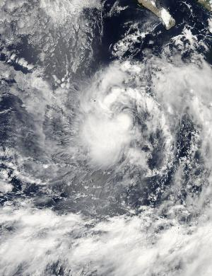 NASA sees fragmented thunderstorm bands wrapped around Tropical Storm Karina