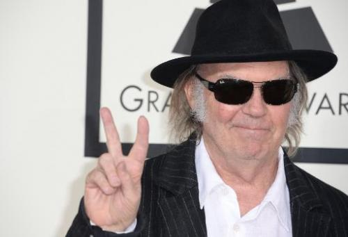 Neil Young arrives on the red carpet for the Grammy Awards at the Staples Center in Los Angeles, California on January 26, 2014