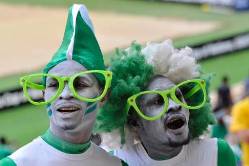 Nigeria fans pose at the 2013 African Cup of Nations final football match against Burkina Faso, on February 10, 2013 in Johannes