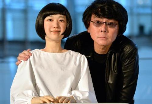 "Osaka University professor Hiroshi Ishiguro (R) displaying the world's first news reading humanoid robot ""Kodomoroid"""