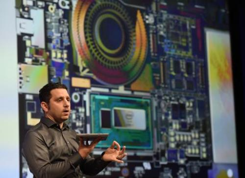 Panos Panay, corporate vice president with Microsoft's Surface division, holds the new Microsoft Surface Pro 3 tablet during a p