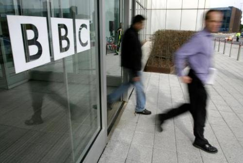 People leave the BBC building in West London on March 21, 2005
