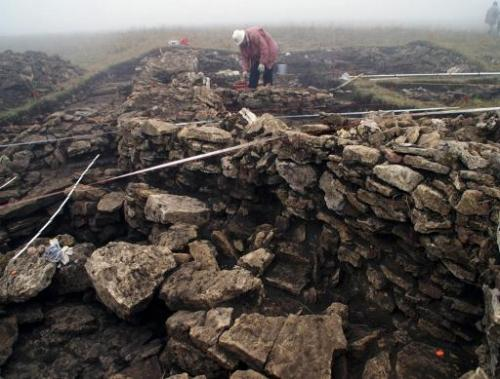 People work on an excavation site in the mountains south of Kislovodsk, Russia in October, 2009