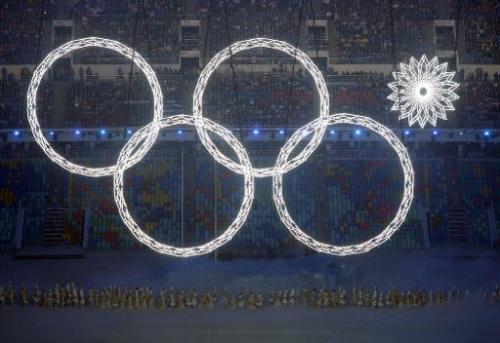 Performers sing as the Olympic rings are presented during the Opening Ceremony of the Sochi Winter Olympics, at the Fisht Olympi