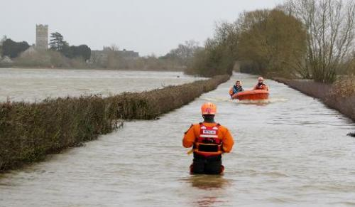 Rescuers carry out operations following flooding in Muchelney, Somerset on January 6, 2014