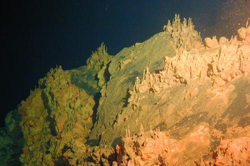 Rust villages of the deep: In Pele's shadow, iron oxide, or rust, comes to life