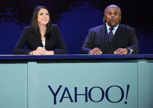 """Saturday Night Live"" members Cecily Strong (L) and Kenan Thompson perform a SNL ""Weekend Update"" sketch during the keynote addr"
