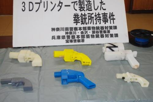Seized guns made with a 3-D printer are displayed at a police station in Yokohama on May 8, 2014