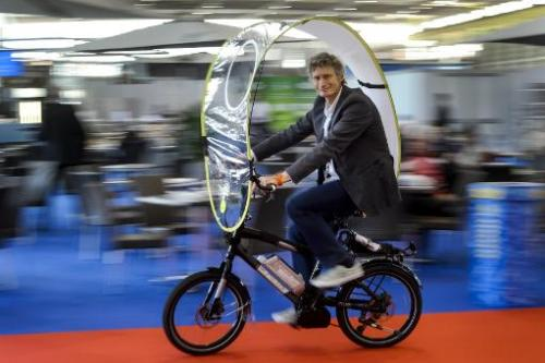 Swiss inventor Rene Wuttig presents a foldable protection against rain and bad weather for bicycles and e-bikes, during the open