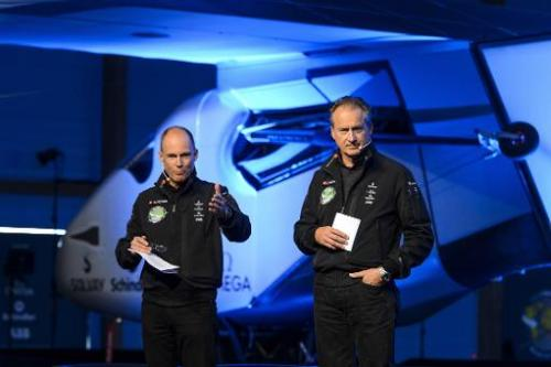 Swiss pilots Bertrand Piccard (L) and Andre Borschberg, who flew the Solar Impulse experimental solar-powered plane on a transco