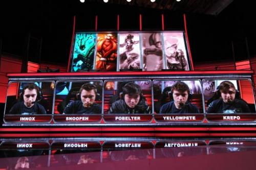 "Team members including ""Krepo"" of the ""Evil Genius"" team are seen on the screen during the live taping of th"