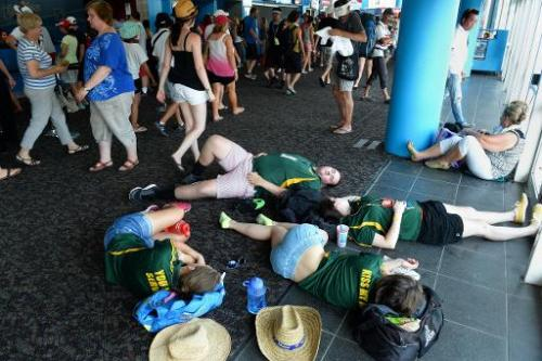 Tennis fans rest indoors after play was suspended due to 'extreme' heat on day four of the Australian Open tournament, in Melbou