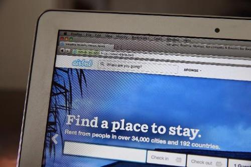 The Airbnb website is displayed on a laptop on April 21, 2014 in San Anselmo, California
