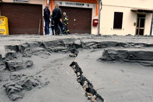 The central street of San Carlo village is damaged following a powerful earthquake that shook Italy's industrial and densely pop