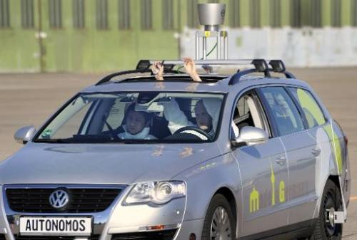 "The driverless car ""Made in Germany"" (MIG) is put through its paces at Berlin's disused Tempelhof airport, on October"
