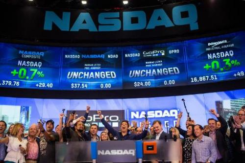 The GoPro team celebrates during the company's initial public offering (IPO) at the Nasdaq Stock Exchange on June 26, 2014 in Ne