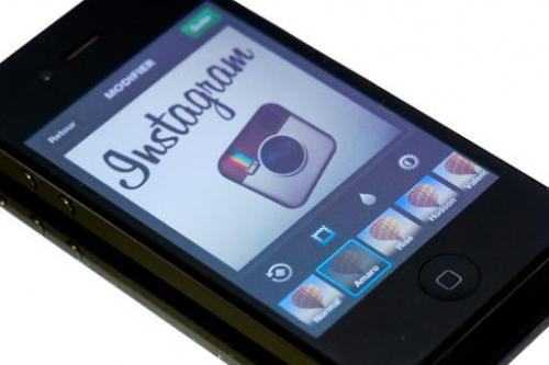 The Instagram logo is displayed on a smartphone on December 20, 2012 in Paris