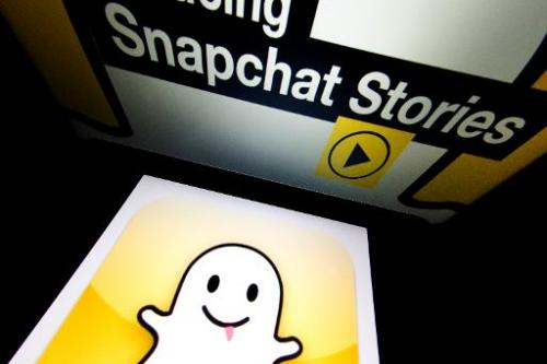 "The logo and a page of mobile app ""Snapchat"" are displayed on tablets on January 2, 2014 in Paris"
