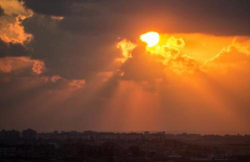 The sun setting over the Gaza strip on July 19, 2014