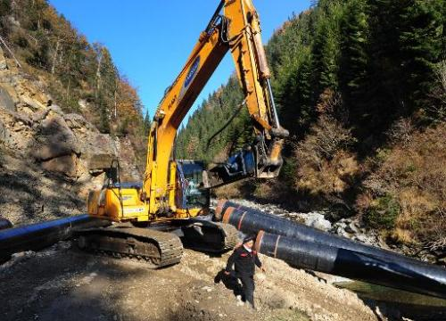 This picture taken on November 2, 2011 shows an excavator working in the bed of a stream in a protected area of the European Nat