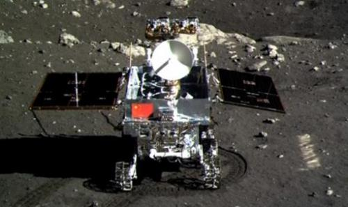 This screen grab, taken from a CCTV footage, shows a photo of the Jade Rabbit moon rover, taken by the Chang'e-3 probe lander on