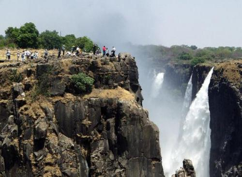 Tourists view the Victoria Falls in Livingstone, Zambia, on November 11, 2004