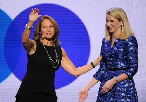 Yahoo Global Anchor Katie Couric (L) on stage with Yahoo CEO Marissa Mayer speaks during Mayer's keynote address at  the 2014 In