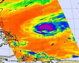 Tropical storm Omais weakens and doubles in size