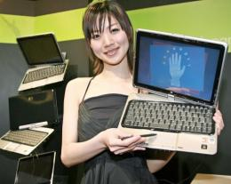 File photo shows a model posing with a Hewlett-Packard tablet PC