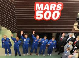 Members of the Mars500 crew wave before being locked into the isolation facility in Moscow,