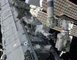 Space station cooling normally after spacewalk fix (AP)