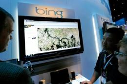 Microsoft's Roger Wong (2nd R) demonstrates maps using Bing