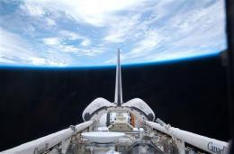 Space shuttle closing in for space station docking (AP)