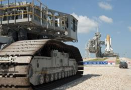 Shuttles carried to the pad by slow-motion giants