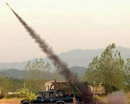 A cloud-bursting rocket being launched from a mobile unit in Jian