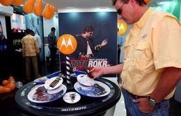 A customer checking out Motorola phones at a store