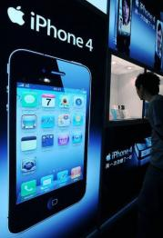 A man looks at the iPhone 4