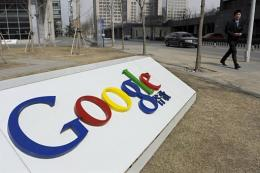 A man walks past the Google company logo outside the Google China headquarters in Beijing in March