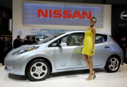 A model poses next to Nissan's electric