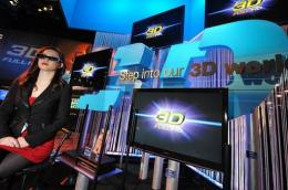 A model wears 3D glasses at a 3D display at the 2010 International Consumer Electronics Show